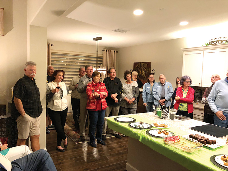 Neighbors finishing dessert at the Doepke home, and anxiously waiting to find out who had the highest winning score for the evening.