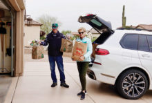Jane and Bill Lockett deliver groceries to neighbors.