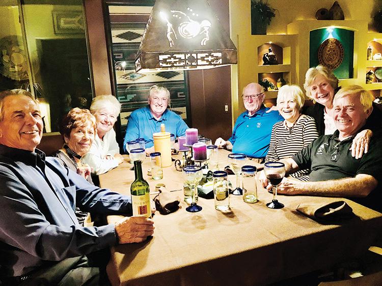 Auctioneer Richard Martin and friends enjoying their dinner.