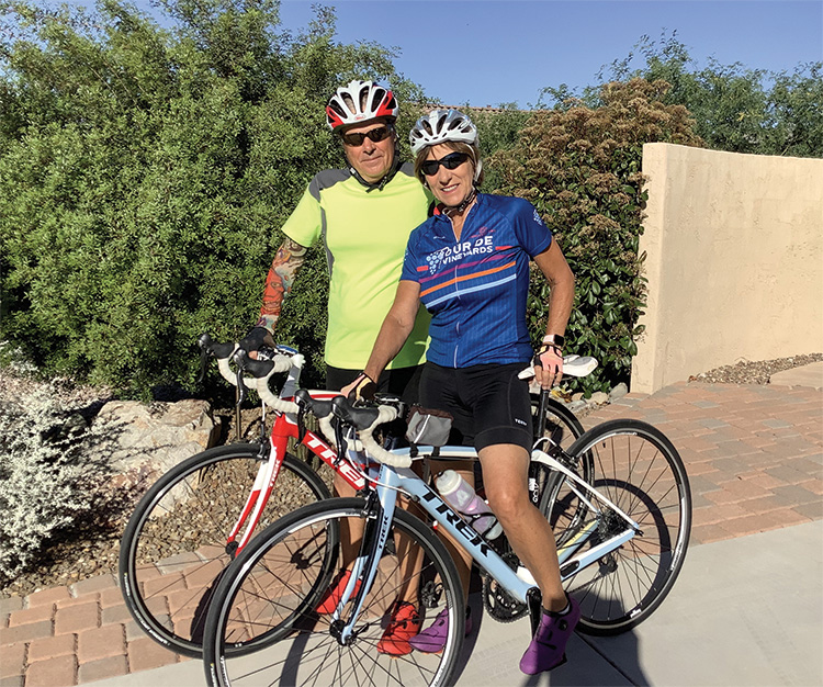 Marci and John Whitehead set off for a morning bike ride as part of Unit 8A's journey across the country and back using their exercise miles. The Whiteheads walked and rode more than 650 miles during the month-long trip.