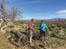 Steve Hanns and Jennifer Black ride their bicycles regularly in the desert.