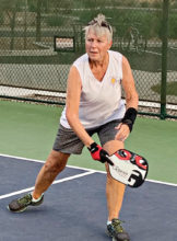 Treasurer Deb Lawson's backhand was in (safe?) cracking form and won the point!