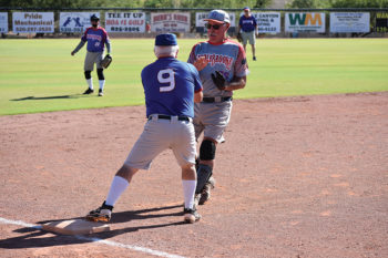 Dave Kraut tags out Tim Benjamin on a close play at third base in a recent Senior Softball Recreation League game at SaddleBrooke. The league is open to all Ranch residents.