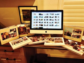 Here I am, sharing with you the computer screen with the photo book application and some of the books I made.