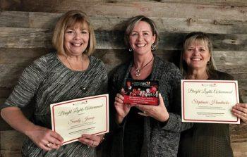 Sandy Jessop, Stephanie Hendricks, and Carol Smith accepting individual and team fundraising awards.