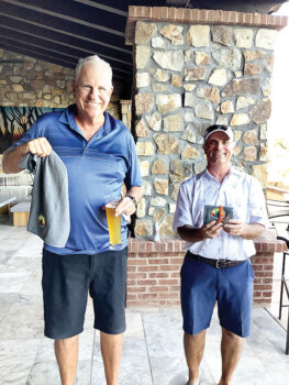 Winner of the long drive was Rich Osterlund (left) and winner of the closest to the pin was Bill Oprish. Each winner received a golf towel with the new Unit 8A logo embroidered on it.