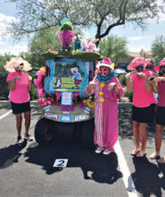 First place cart decorators, Bow Wow Babes: Lee Rinke, Toni Graves, Lorraine Smith, Terri Movius, Mindy Hawkins, Barb Simms, and Lynn Fidler