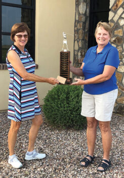 SBRWGA President, Jeanne Osterlund, presenting the Club Championship trophy to Jean Cheszek.