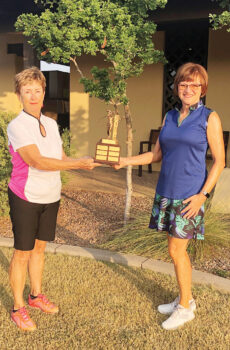 SBRWGA President, Jeanne Osterlund, presenting the Senior Club Championship trophy to Mary Snowden.