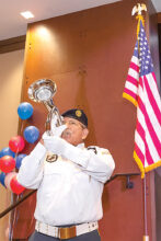 Bugler Rick Gonzales playing Taps to honor the fallen troops. (Photo by Steve Weiss)