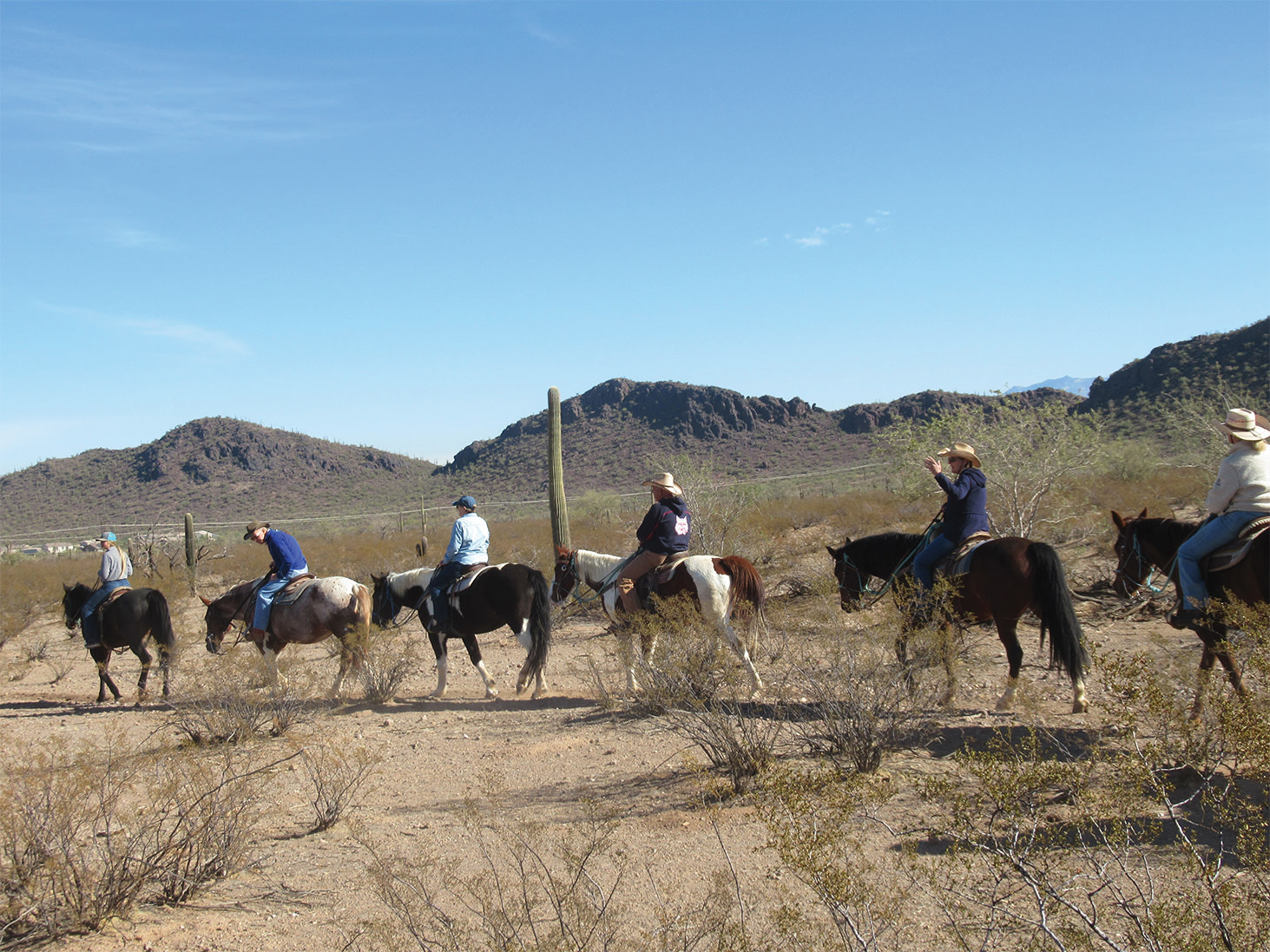Left to right: Wrangler, Jeff Smith, Nancy Gruca, Rob Densmore, Judy Smith, and Tess Densmore enjoy the trail.