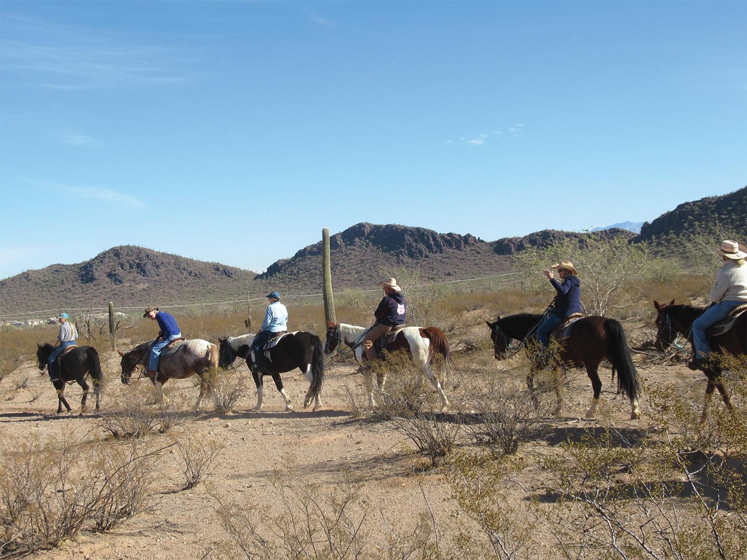 Left to right: Wrangler, Jeff Smith, Nancy Gruca, Rob Densmore, Judy Smith, and Tess Densmore enjoy the trail.