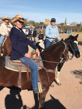 Left to right: Tess Densmore, Judy Smith, and Nancy Gruca are mounted up and ready to go while Debbie Trapp and two more riders await their turn in the background.