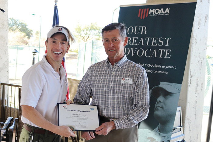 Colonel Nagy presents a Certificate of Appreciation and MOAA challenge coin to Commander Orvik.
