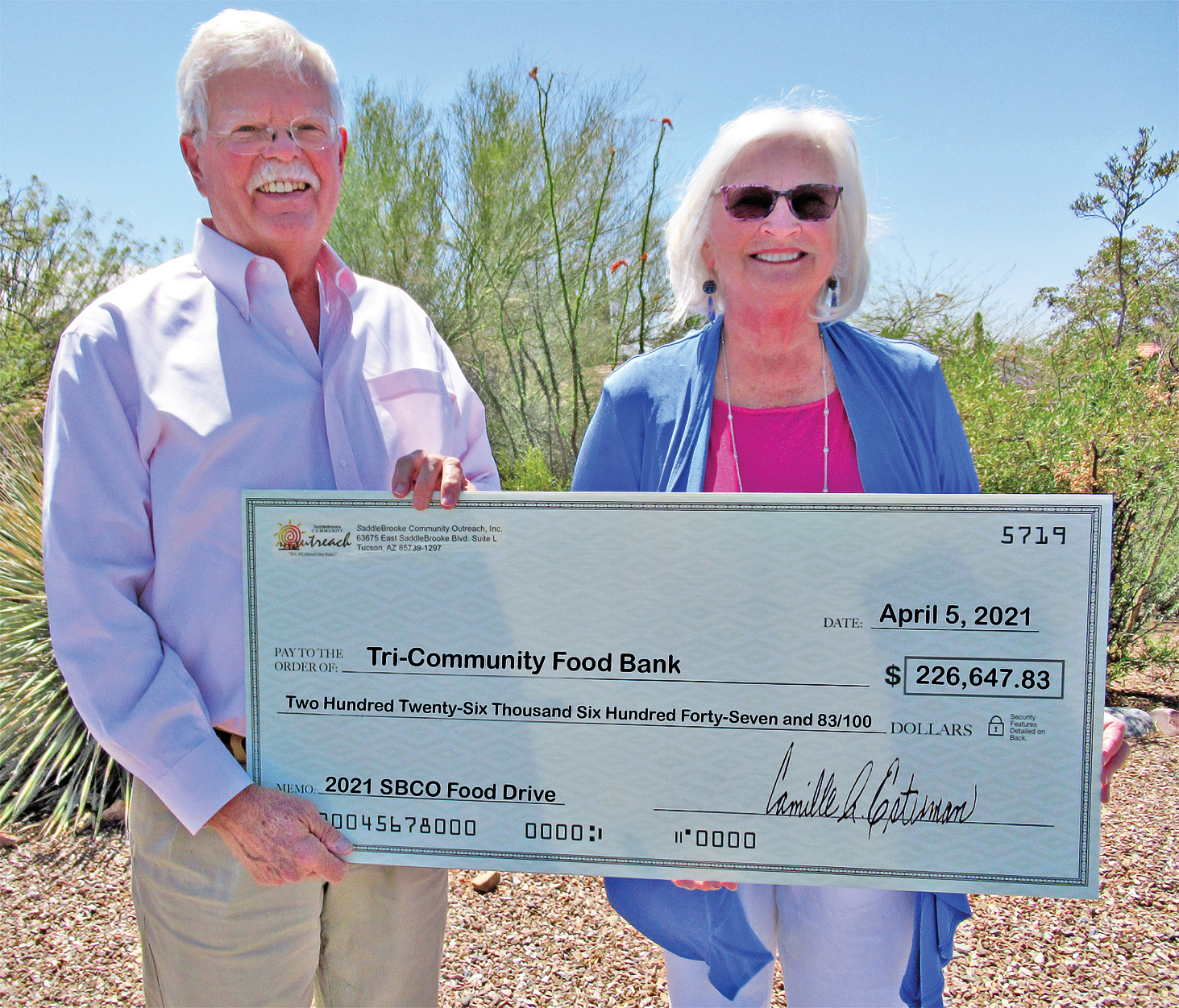 Steve Groth, SBCO president, presents a check for the $226,647 raised by the SBCO Food Drive to Tri-Community Food Bank chairperson, Cynthia Chevalley.