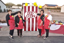 Laverne, Shirley, Ethyl, and Lucy (Janelle Authur, Denise Doepke, Judie Townsend, and Kate Thomsen) welcome residents to the concession stand for candy and popcorn. (Photo by Steve Weiss)
