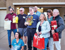 """Eight raffle prizes were awarded at Unit 8A's """"Drive-In"""" Through the Years event in March. Prize winners were Maia Schenkel (front), (left to right) Bob Townsend, Paul Picchiottino, Ron Dennis, Kevin Hand (background), Betty Ryan, Vicki Froistad, and Dick Ryan."""