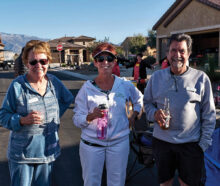 """Nancy Tuel, CJ Utecht, and Floyd Tuel enjoy an evening at the drive-in during Unit 8A's """"Drive-In"""" Through the Years event on March 19."""