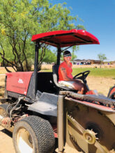 Crystal Gilbert and the SaddleBrooke Ranch maintenance crew are working with Oliphant, Inc. to install the new greens, while still maintaining the current grounds and landscaping. Construction of new homes continues in the background.