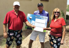 Paul Thomsen (center) with Joe and Patty Cimo, gross score champions.