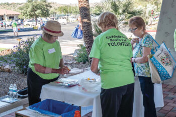 Volunteers are the lifeblood of the Health Fair, whether directing traffic, assisting exhibitors, or helping fairgoers.