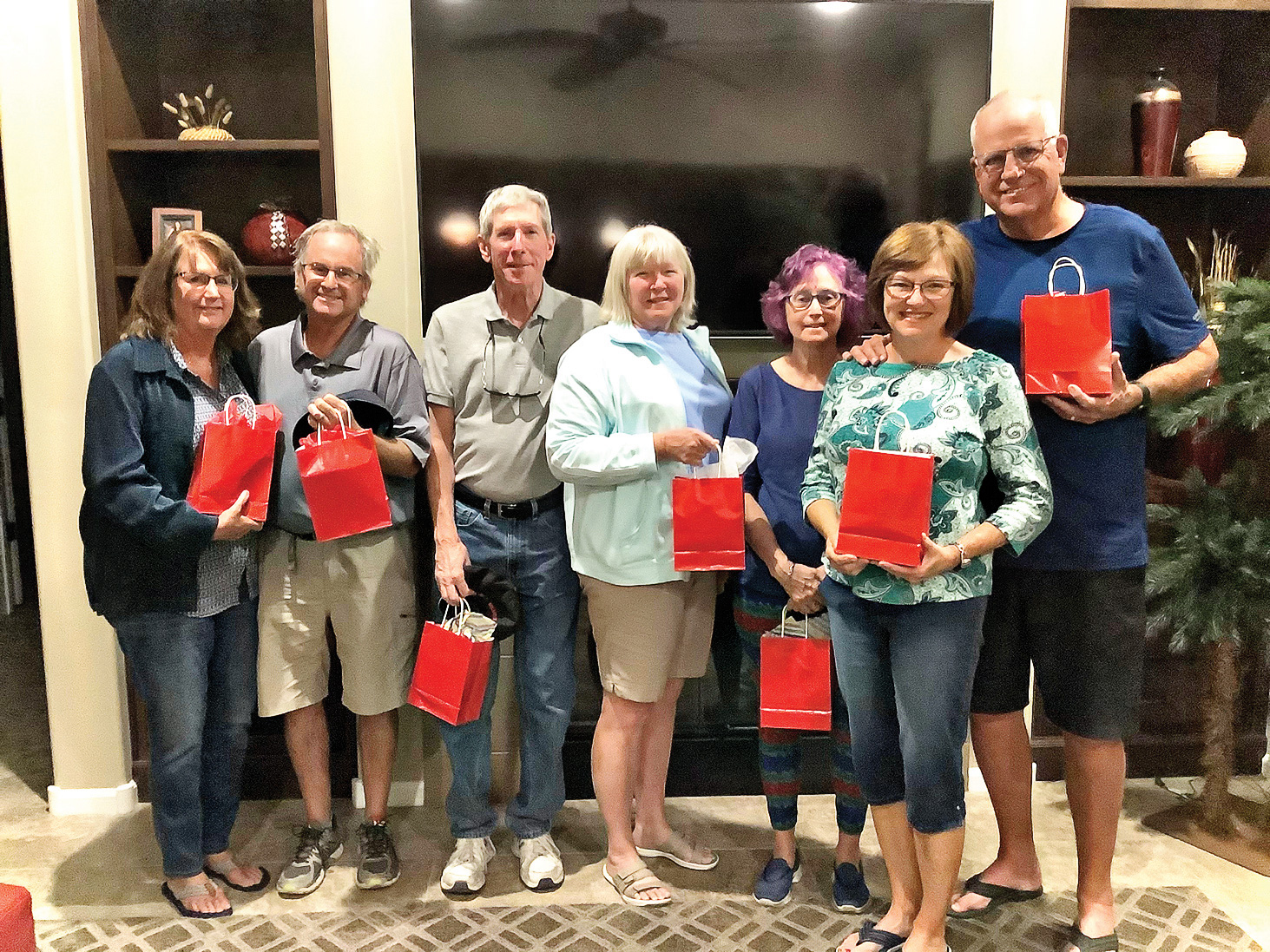 The winners of Unit 8A's April 2021 Tuesday Trivia (left to right): Vicki Froistad, Dave Ambler, Paul and Kate Thomsen, Gail Latimer, and Jeanne and Rich Osterlund